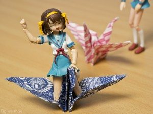 Haruhi riding an paper crane given to me by some Japanese students in Hiroshima, Japan.